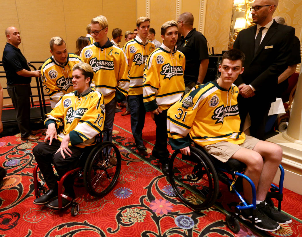 Humboldt Broncos, from left, Kaleb Dahlgren , Ryan Straschnitzki, Graysen Cameron, Xavier LaBelle, Brayden Camrud and Jacob Wassermann prepare to talk to the news media at the Encore at Wynn Las V ...
