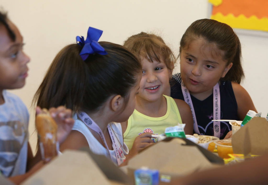 """Mia Gonzalez, 5, second left, and her twin sister Amy, right, chat with their friend Megan Bravo, 6, during """"Meet Up to Eat Up"""" program at the Boys and Girls Club at 3475 S. Mountain Vis ..."""