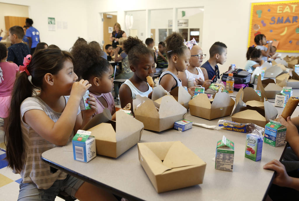 """Children, including Jocelyn Delgadillo, left, and Ariya Spencer, 9, second left, enjoy their breakfast during """"Meet Up to Eat Up"""" program at the Boys and Girls Club at 3475 S. Mountain V ..."""