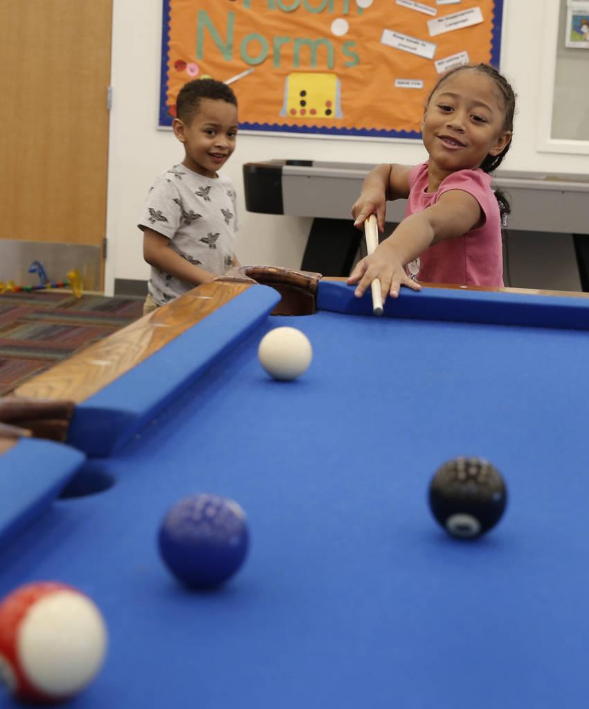 "Armani Valenzuela, 5, watches as his friend Sariya Jonson Milton, 6, plays billiard pool during ""Meet Up to Eat Up"" program at the Boys and Girls Club at 3475 S. Mountain Vista St. on Tu ..."