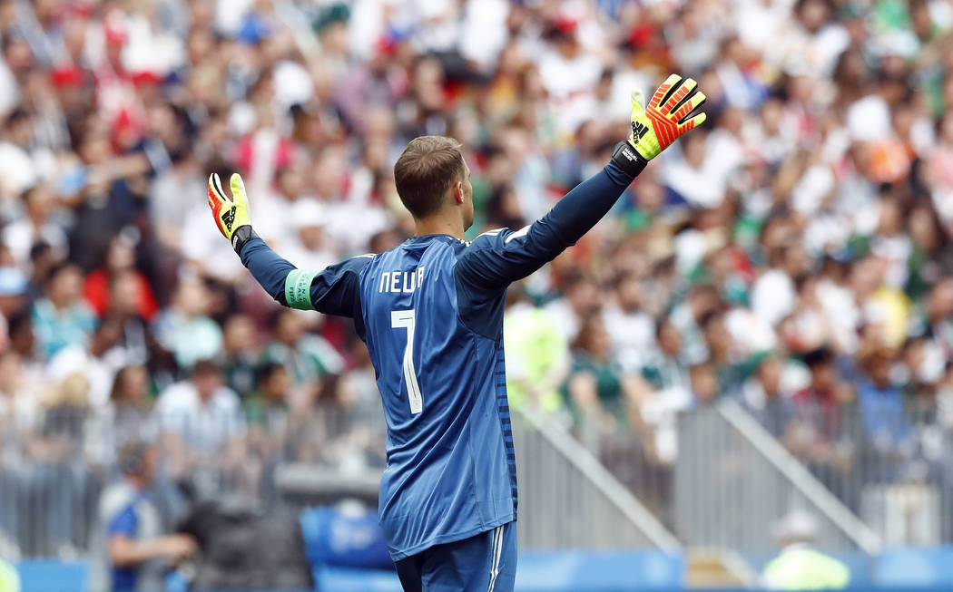 Germany goalkeeper Manuel Neuer gestures during the group F match between Germany and Mexico at the 2018 soccer World Cup in the Luzhniki Stadium in Moscow, Russia, Sunday, June 17, 2018. (AP Phot ...