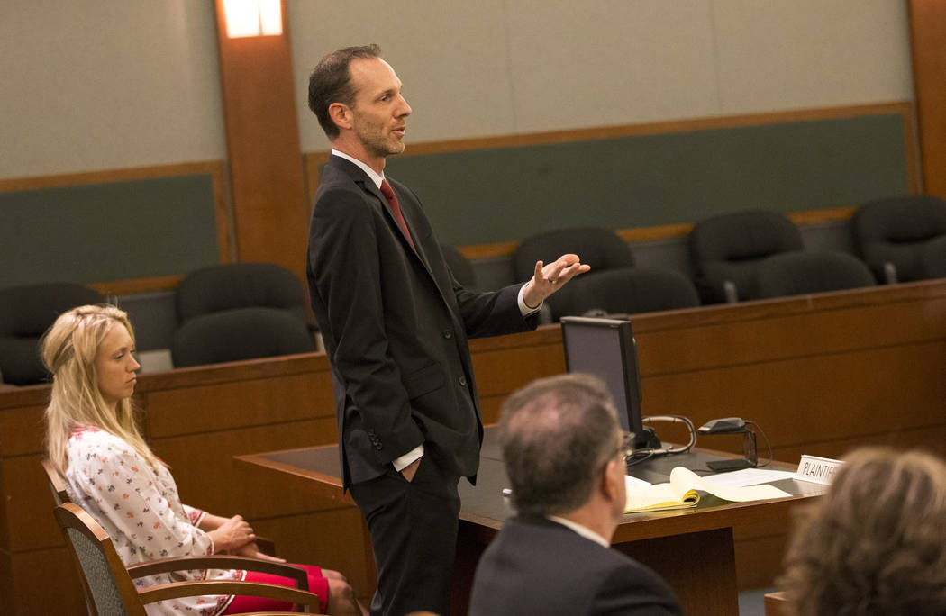 Save Red Rock President Heather Fisher, left, listens in as her attorney Justin Jones, center, argues before Judge Jerry Wiese during a hearing regarding a proposed development on Blue Diamond Hil ...