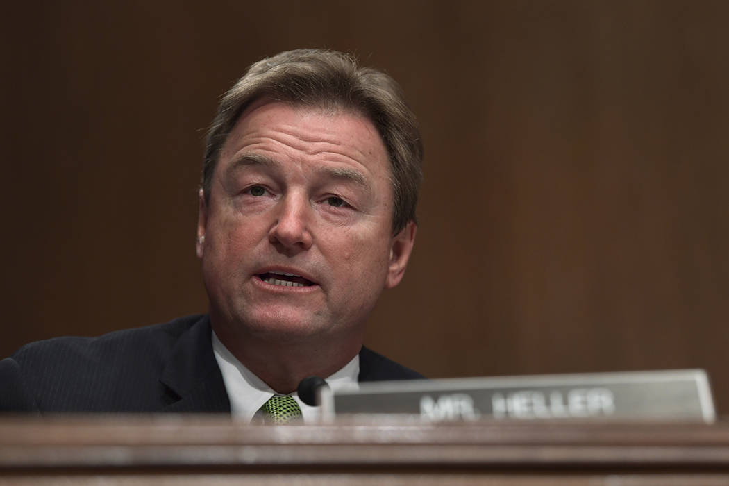 Sen. Dean Heller, R-Nev., asks a question of Treasury Secretary Steven Mnuchin during a Senate Banking Committee hearing on Capitol Hill in Washington, Tuesday, Jan. 30, 2018, on the Financial Sta ...