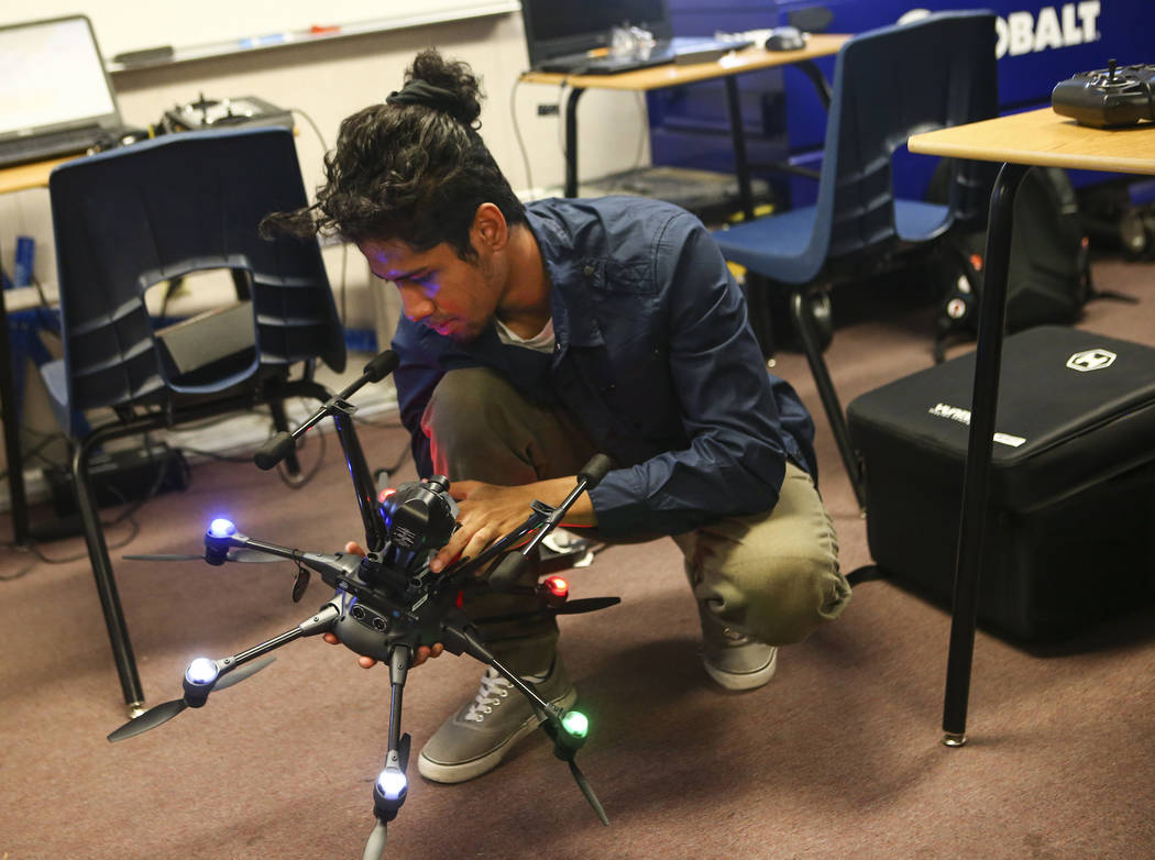 Christopher Steele works on setting up a drone at Nevada Partners Resource Center in Las Vegas on Tuesday, June 19, 2018. The Regional Workforce Development Center, which will house the new Intel ...