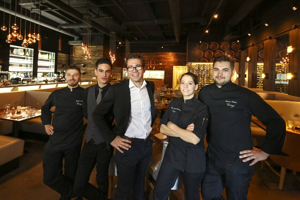 Partage manager and owner Nicolas Kalpokdjian, center, is flanked by members of his staff, from left, Gabriel Mietz, William Engelstein, Sabine Pendaries- Issaurat and Vincent Pellerin at the mode ...