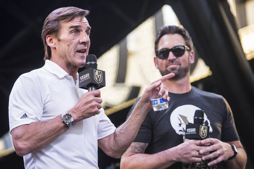 "Golden Knights general manger George McPhee, left, thanks the fans for their support during ""Stick Salute to Vegas and Our Fans"" on Wednesday, June 13, 2018, at the Fremont Street Ex ..."