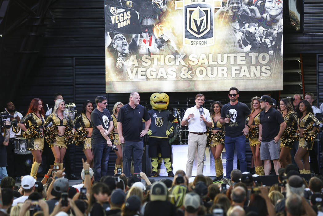 "George McPhee, general manager of the Golden Knights, center right, addresses the crowd alongside head coach Gerard Gallant during the ""Stick Salute to Vegas and Our Fans"" held by the Go ..."