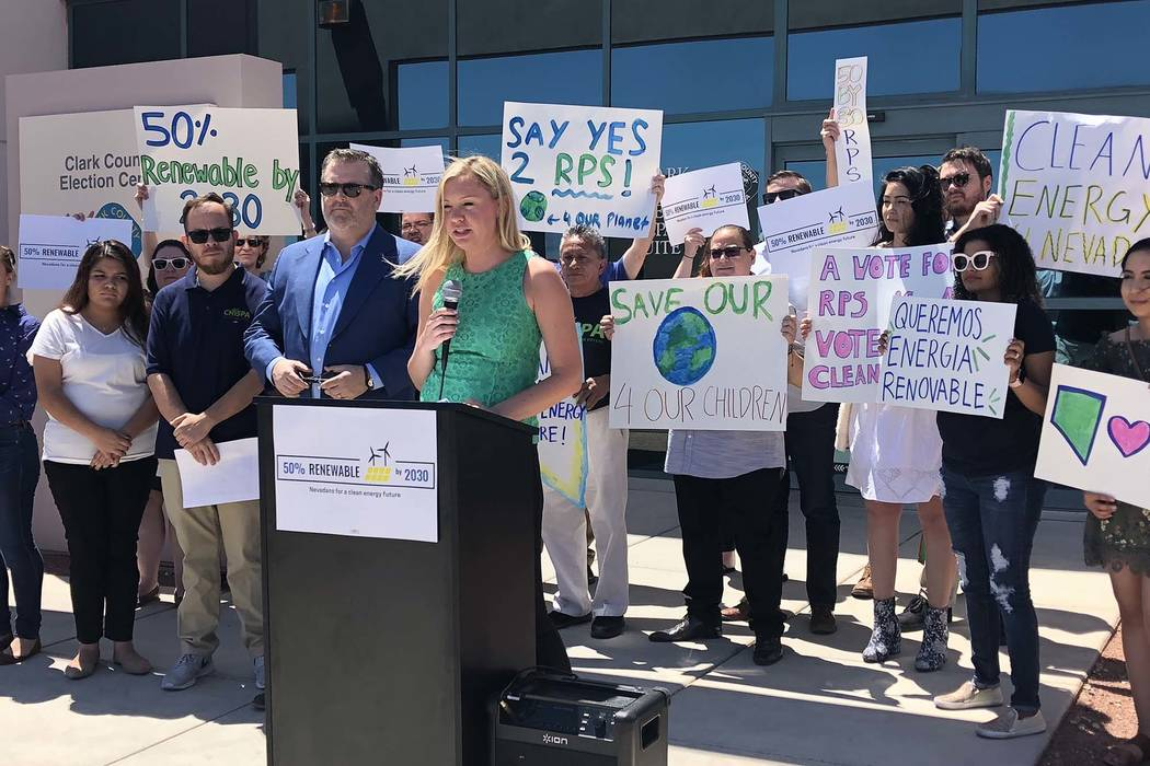 Katie Robbins, with Nevadans for a Clean Energy Future, speaks after the group submitted more than 230,000 signatures to put a renewable energy measure on the November ballot. (Nevadans for a Clea ...
