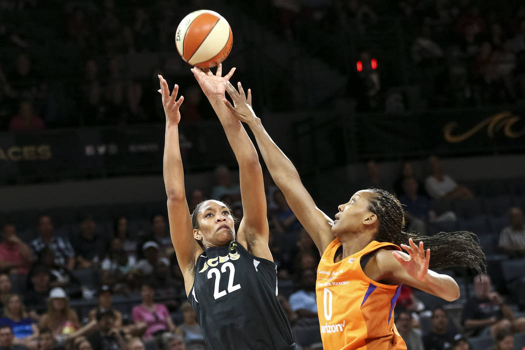 Las Vegas Aces center A'ja Wilson (22) shoots for a point over Phoenix Mercury forward Angel Robinson (0) during the first half of a WNBA basketball game at the Mandalay Bay Events Center in Las V ...