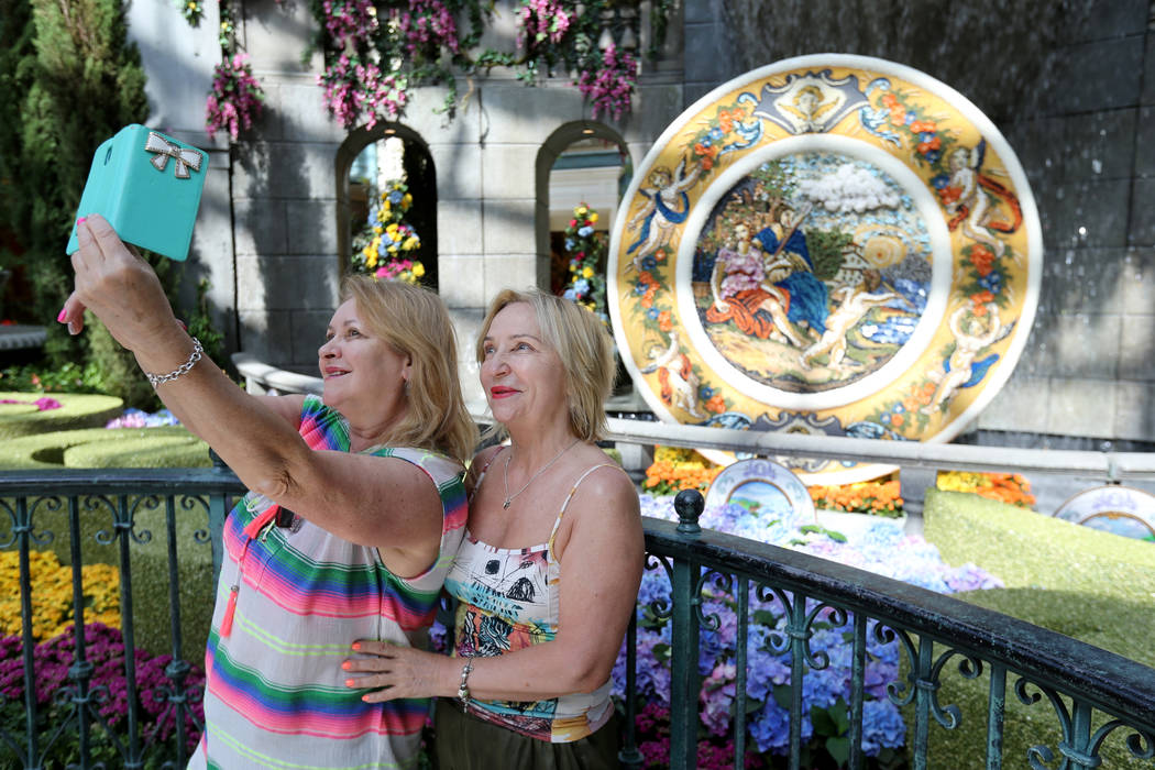 Guests who declined to give their names take a selfie at ÒThatÕs AmorŽ,Ó the Bellagio Conservatory's summer display Monday, June 18, 2018. The display, based on an Italian sum ...