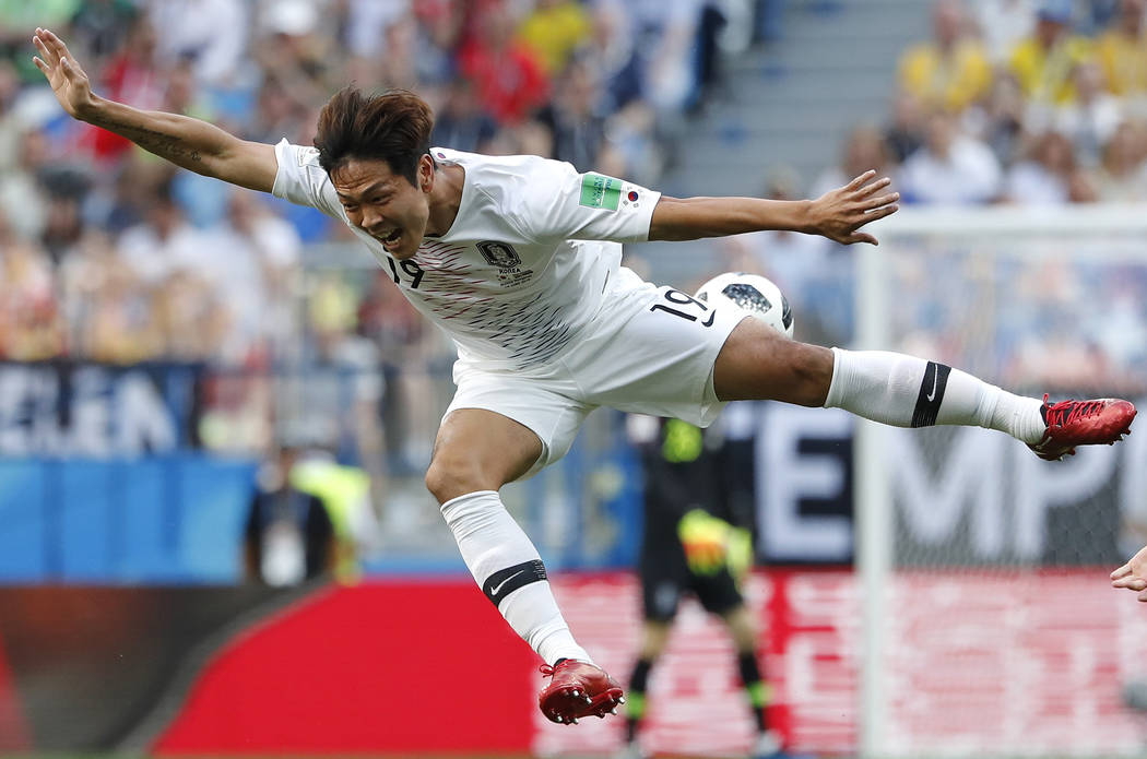 South Korea's Kim Young-gwon goes airborne during a challenge with Sweden's Marcus Berg during the group F match between Sweden and South Korea at the 2018 soccer World Cup in the Nizhny Novgorod ...