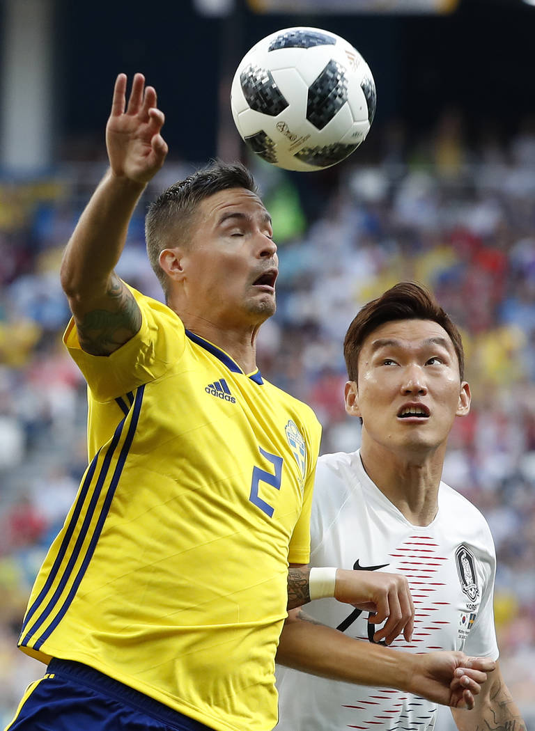 Sweden's Mikael Lustig, left, and South Korea's Jang Hyun-soo battle for the ball during the group F match between Sweden and South Korea at the 2018 soccer World Cup in the Nizhny Novgorod stadiu ...