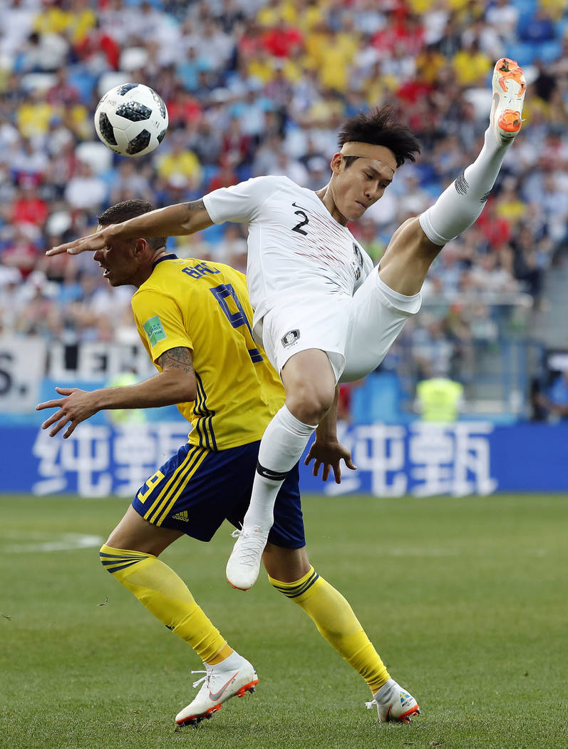 South Korea'sLeeYong is challenged by Sweden's Marcus Berg during the group F match between Sweden and South Korea at the 2018 soccer World Cup in the Nizhny Novgorod stadium in Nizhny ...