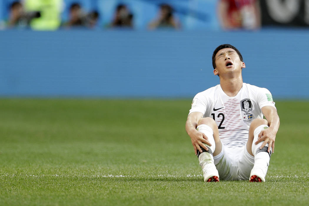 South Korea's Kim Min-woo sits on the pitch at the end of the group F match between Sweden and South Korea at the 2018 soccer World Cup in the Nizhny Novgorod stadium in Nizhny Novgorod, Russia, M ...