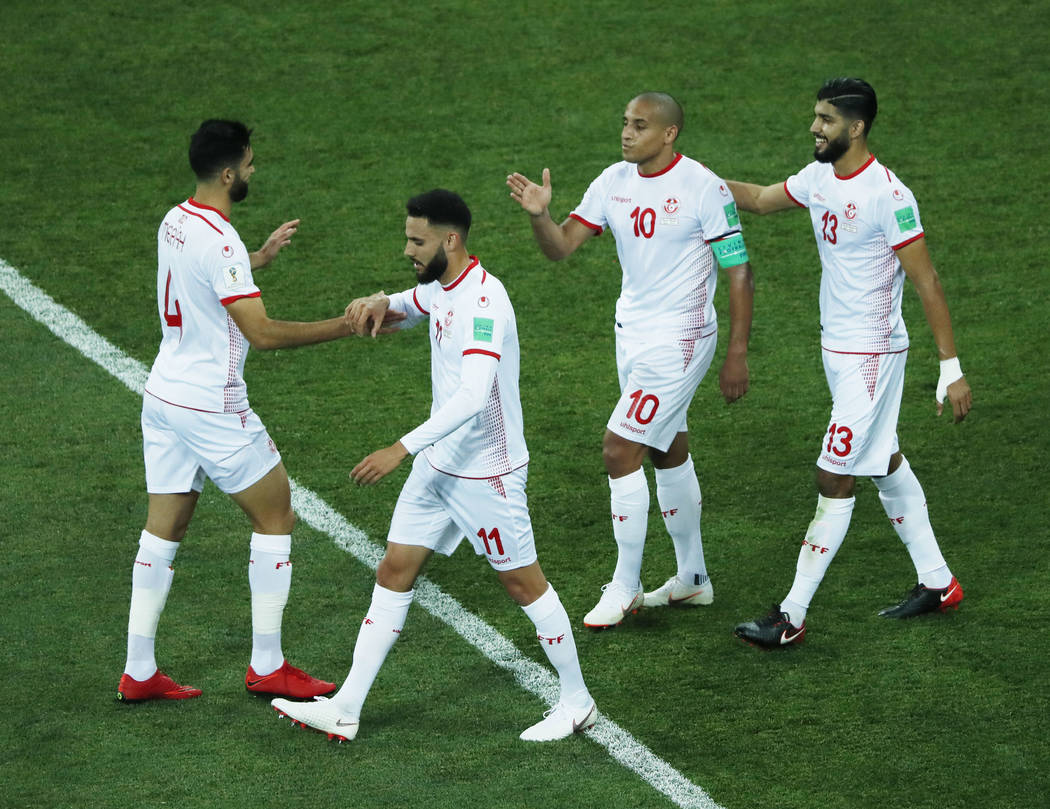 Tunisian players celebrate their side's equalizing goal during the group G match between Tunisia and England at the 2018 soccer World Cup in the Volgograd Arena in Volgograd, Russia, Monday, June ...
