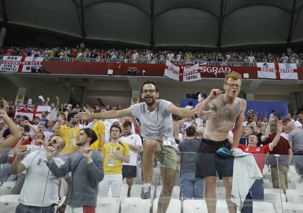 England's fans celebrate at the end of the group G match between Tunisia and England at the 2018 soccer World Cup in the Volgograd Arena in Volgograd, Russia, Monday, June 18, 2018. (AP Photo/Than ...