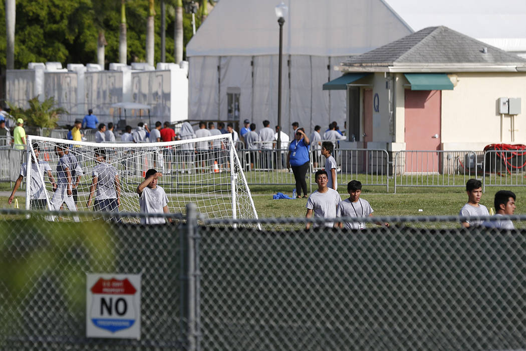 Immigrant children play outside a former Job Corps site that now houses them, Monday, June 18, 2018, in Homestead, Fla. It is not known if the children crossed the border as unaccompanied minors o ...