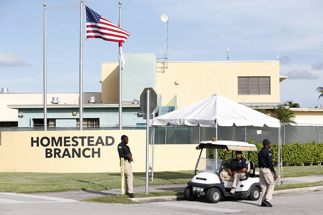 Security guards stand outside a former Job Corps site that now houses child immigrants, Monday, June 18, 2018, in Homestead, Fla. It is not known if the children crossed the border as unaccompanie ...