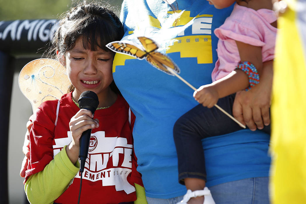 Akemi Vargas, 8, cries as she talks about being separated from her father during an immigration family separation protest in front of the Sandra Day O'Connor U.S. District Court building, Monday, ...