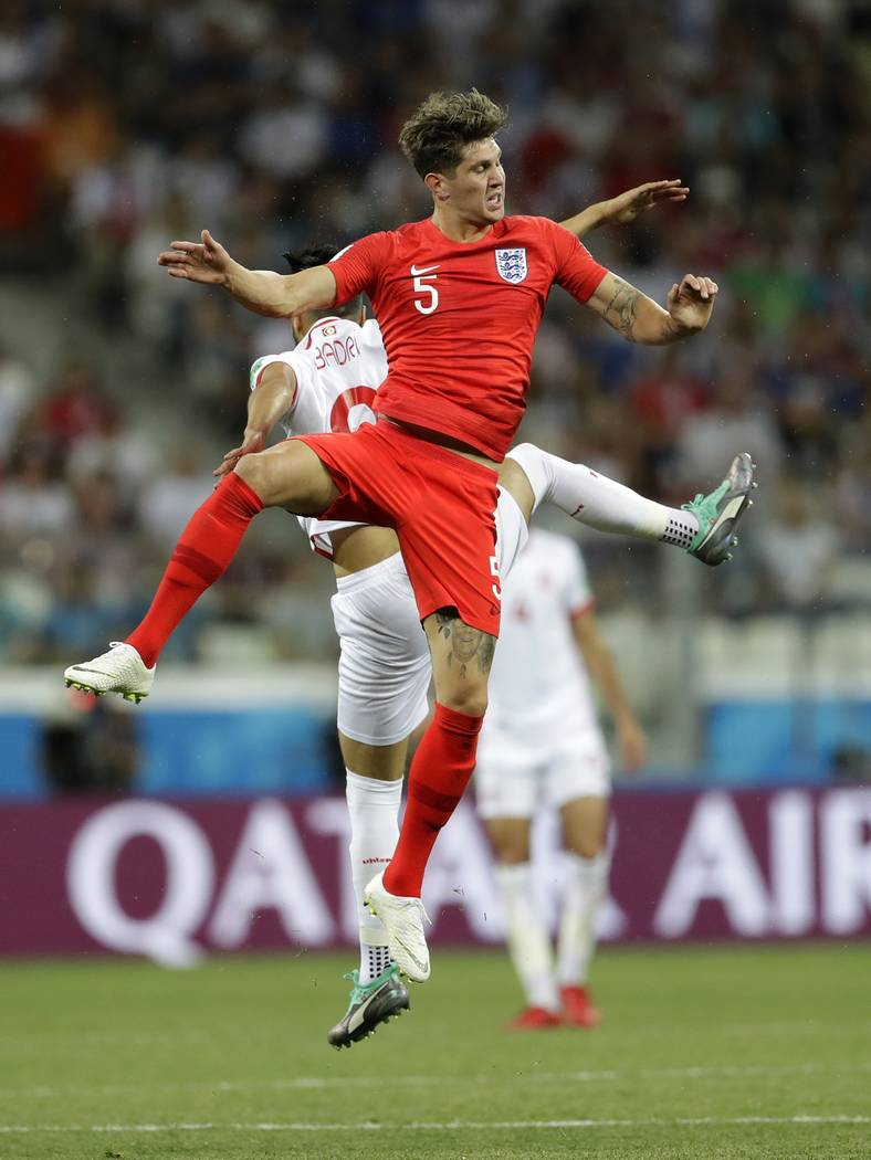 England's John Stones, foreground, and Tunisia's Anice Badri, jump for the ball during the group G match between Tunisia and England at the 2018 soccer World Cup in the Volgograd Arena in Volgogra ...