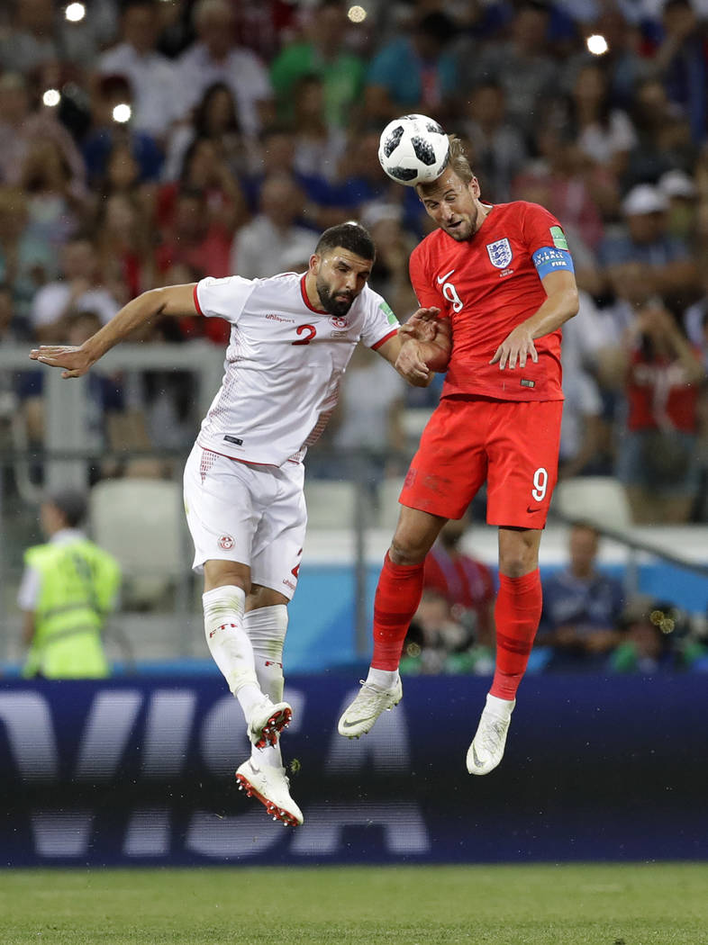 England's Harry Kane, right, and Tunisia's Syam Ben Youssef challenge for the ball during the group G match between Tunisia and England at the 2018 soccer World Cup in the Volgograd Arena in Volgo ...