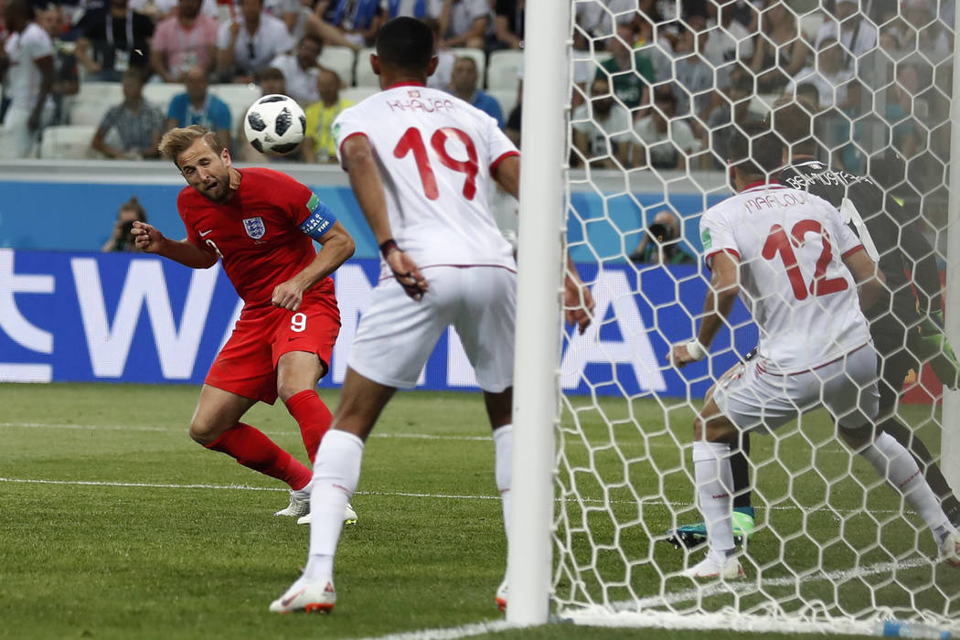 England's Harry Kane scores his side's 2nd goal against Tunisia during a group G match at the 2018 soccer World Cup in the Volgograd Arena in Volgograd, Russia, Monday, June 18, 2018. (AP Photo/Al ...