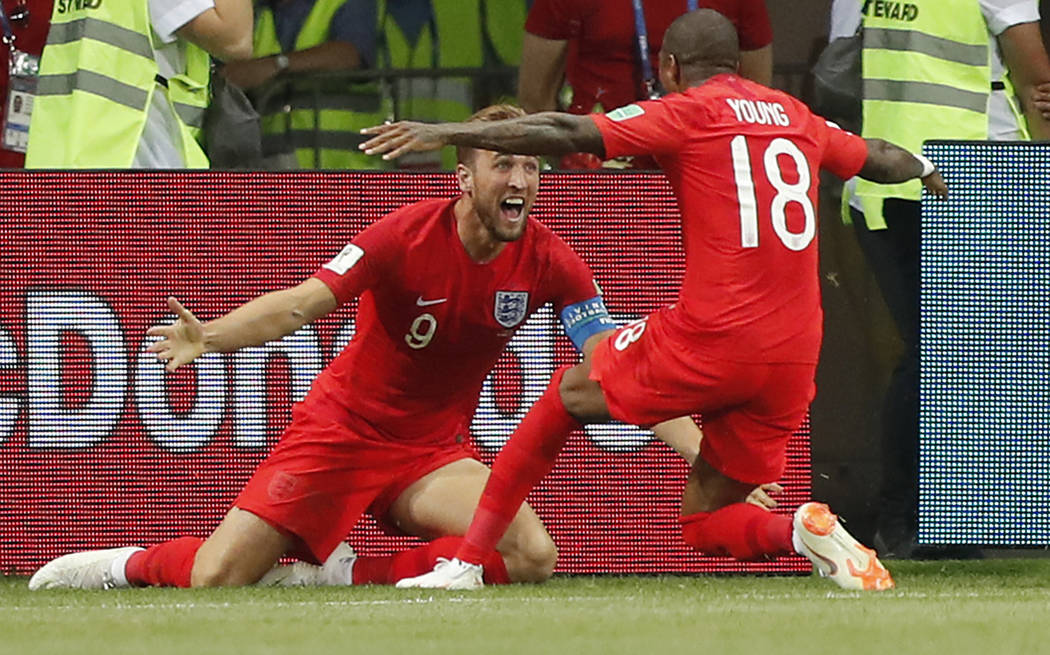 England's Harry Kane, left, celebrates his winning goal with England's Ashley Young during the group G match between Tunisia and England at the 2018 soccer World Cup in the Volgograd Arena in Volg ...