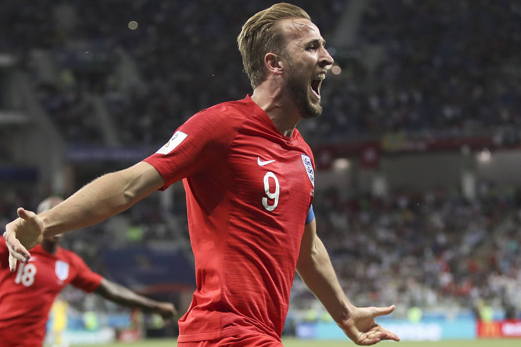 England's Harry Kane celebrates after scoring his side's second goal during the group G match between Tunisia and England at the 2018 soccer World Cup in the Volgograd Arena in Volgograd, Russia, ...