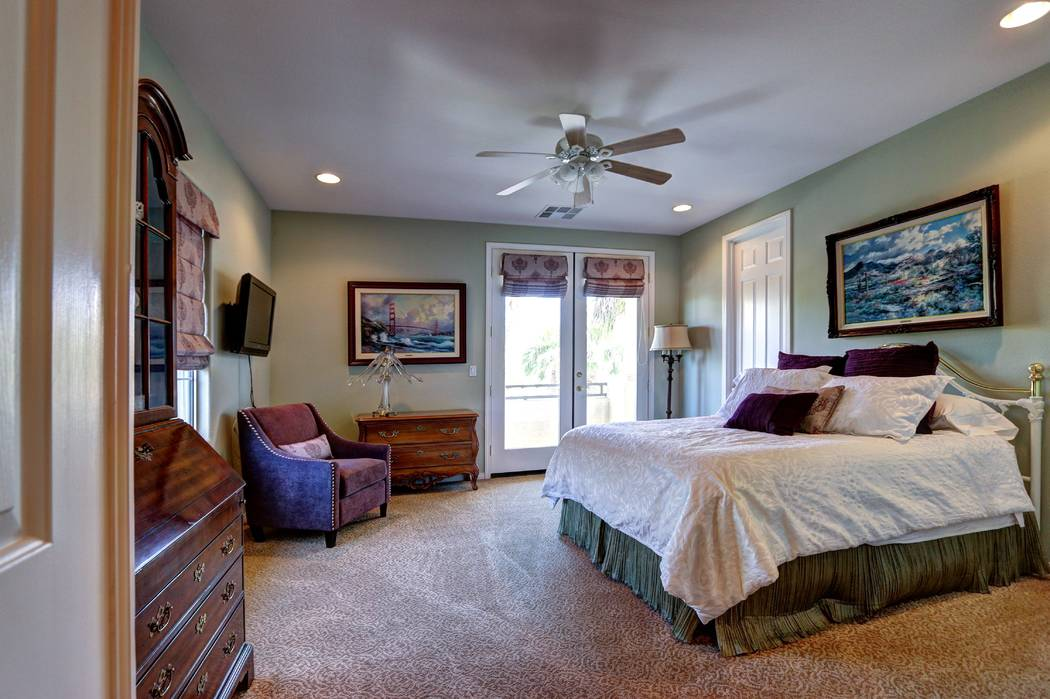 A secondary bedroom opens to the patio. (Lisa Paquette TourFactory)
