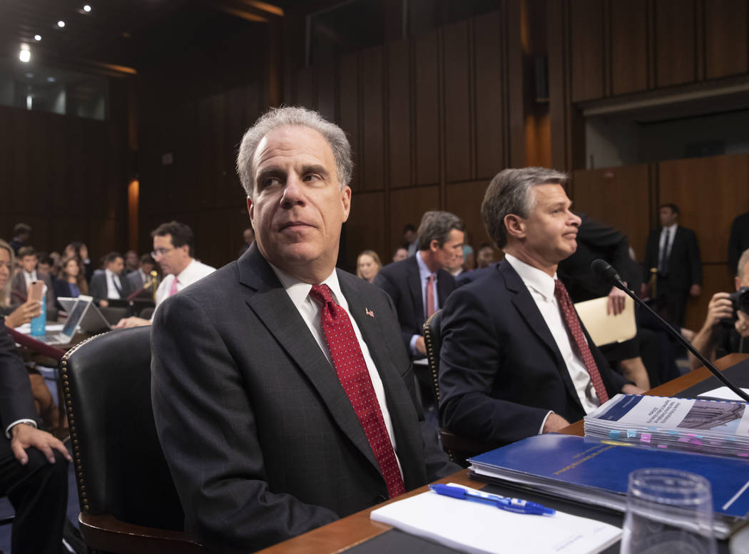 Justice Department Inspector General Michael Horowitz, left, and FBI Director Christopher Wray, arrive to testify as the Senate Judiciary Committee examines the internal report of the FBI's Clinto ...