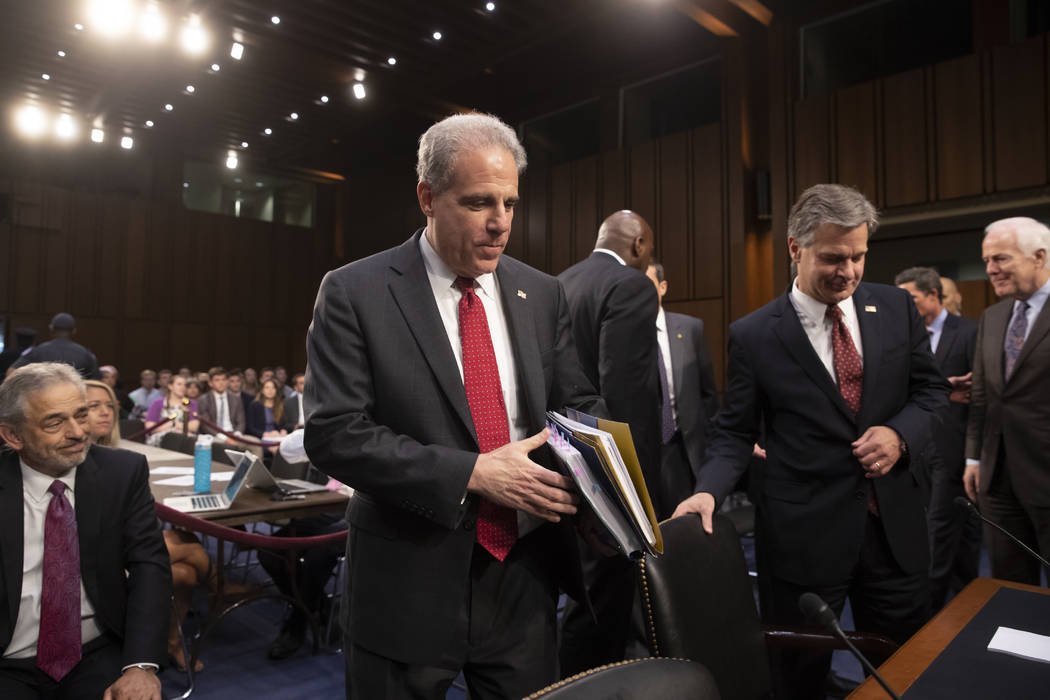 Justice Department Inspector General Michael Horowitz, center, and FBI Director Christopher Wray, right arrive to testify as the Senate Judiciary Committee examines the internal report of the FBI' ...