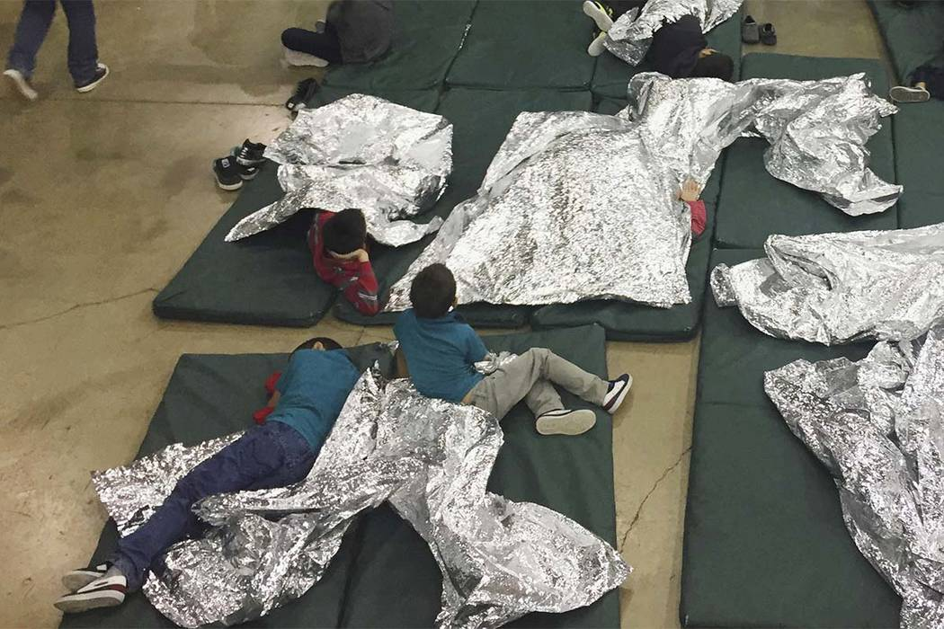 In this photo provided by U.S. Customs and Border Protection, people who've been taken into custody related to cases of illegal entry into the United States, rest in one of the cages at a facility ...