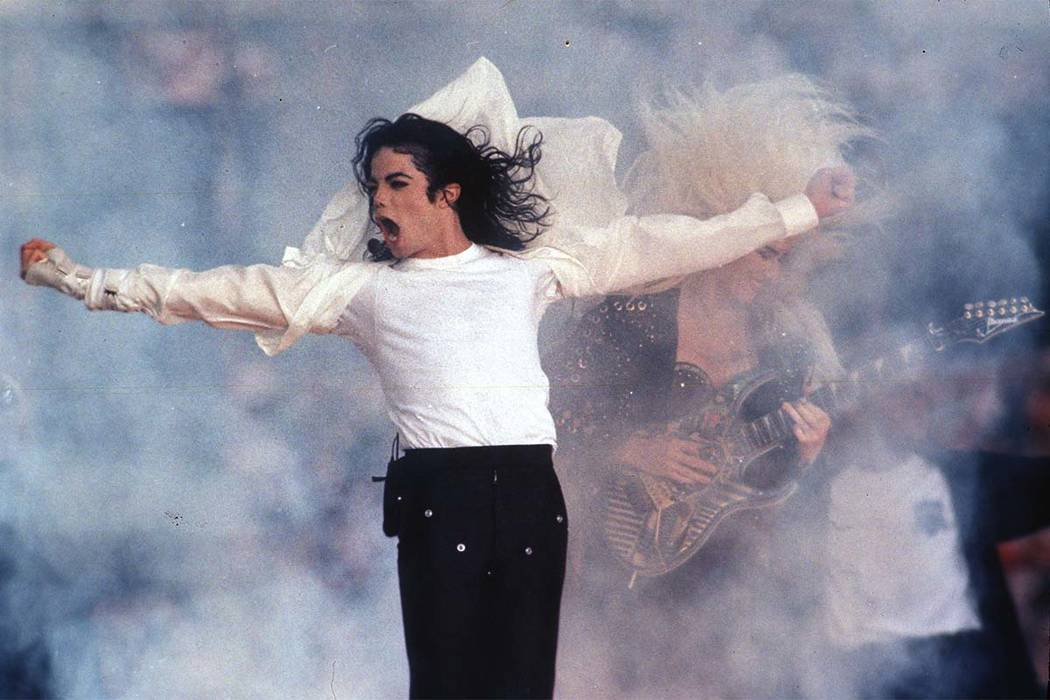 This Feb. 1, 1993 file photo shows Michael Jackson performing during the halftime show at the Super Bowl in Pasadena, California. The Michael Jackson Estate and Columbia Live Stage are unveiling p ...