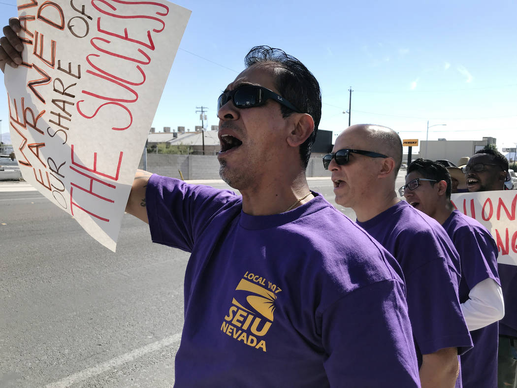Jesse Mendiola, member of the Service Employees International Union, pickets outside the Las Vegas Review-Journal on Tuesday, June 19, 2018 in Las Vegas. The SEIU is in the midst of contract negot ...