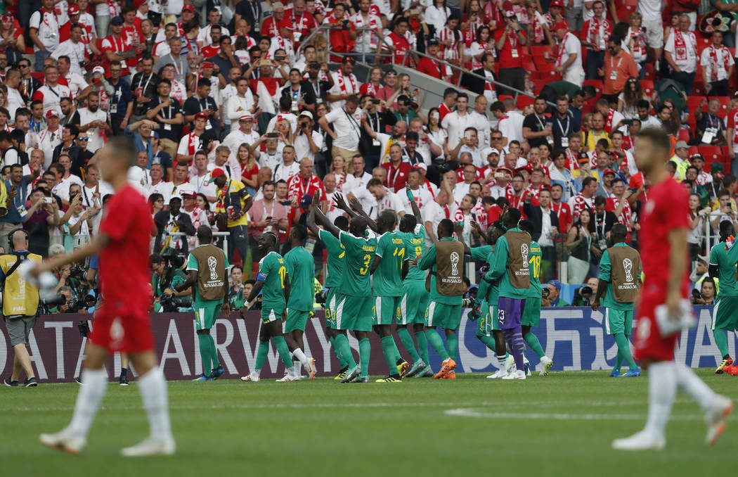 Senegal's players celebrate after winning the group H match between Poland and Senegal at the 2018 soccer World Cup in the Spartak Stadium in Moscow, Russia, Tuesday, June 19, 2018. (AP Photo/Dark ...