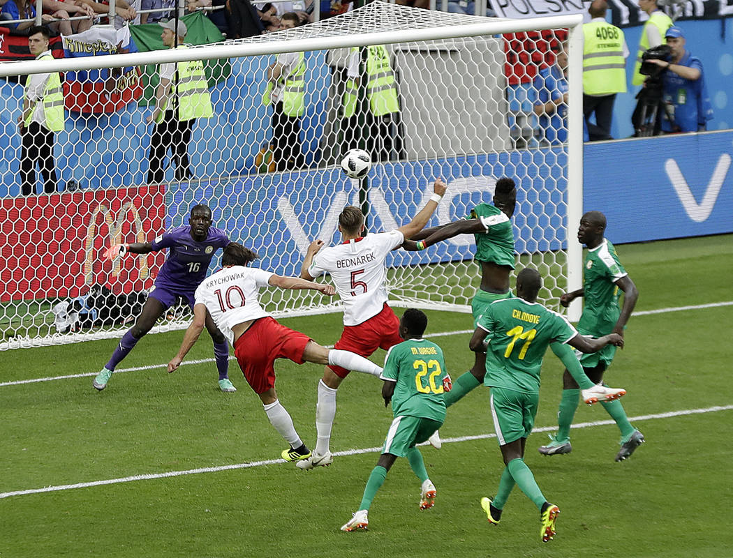 Poland's Grzegorz Krychowiak, left, scores his side's first goal during the group H match between Poland and Senegal at the 2018 soccer World Cup in the Spartak Stadium in Moscow, Russia, Tuesday, ...