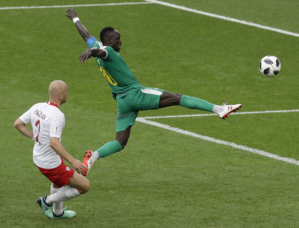 Senegal's Sadio Mane, right, and Poland's Michal Pazdan challenge for the ball during the group H match between Poland and Senegal at the 2018 soccer World Cup in the Spartak Stadium in Moscow, Ru ...