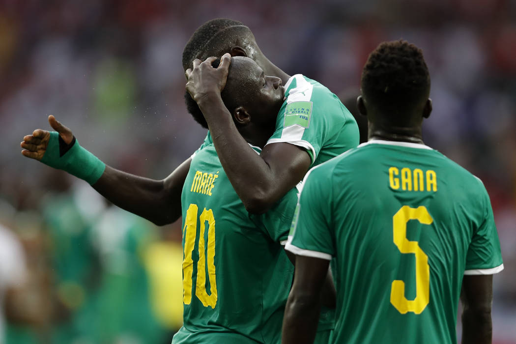 Senegal players celebrate after winning the group H match between Poland and Senegal at the 2018 soccer World Cup in the Spartak Stadium in Moscow, Russia, Tuesday, June 19, 2018. Senegal won Pola ...