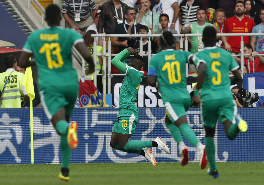 Senegal's Mbaye Niang, 2nd left, celebrates with teammates after scoring his side's 2nd goal during the group H match between Poland and Senegal at the 2018 soccer World Cup in the Spartak Stadium ...