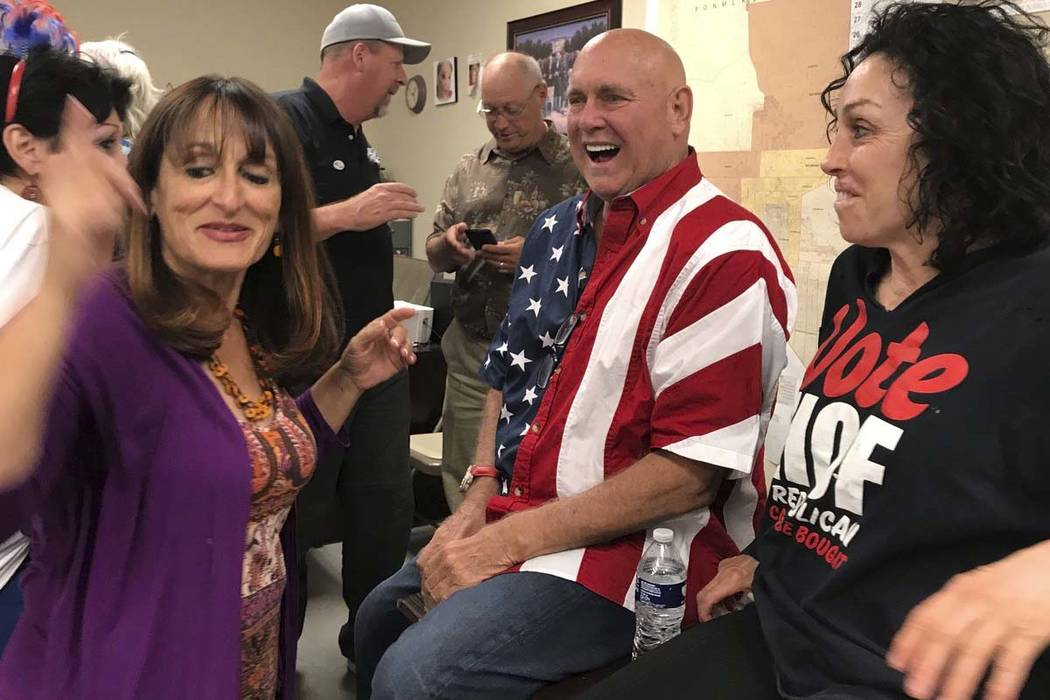 Nevada brothel owner Dennis Hof, second from right, celebrates in Pahrump on June 12 after winning the primary election. Hof, the owner of half a dozen legal brothels in Nevada and star of the HBO ...