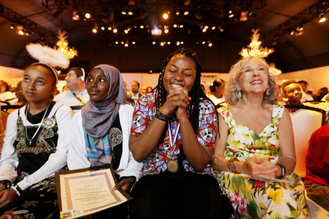 Rosy Mibulano, 19, second from right, reacts to winning a scholarship during the Second Annual Refugee Recognition Ceremony at the Silverton in Las Vegas Wednesday, June 20, 2018. Mibulano, from t ...