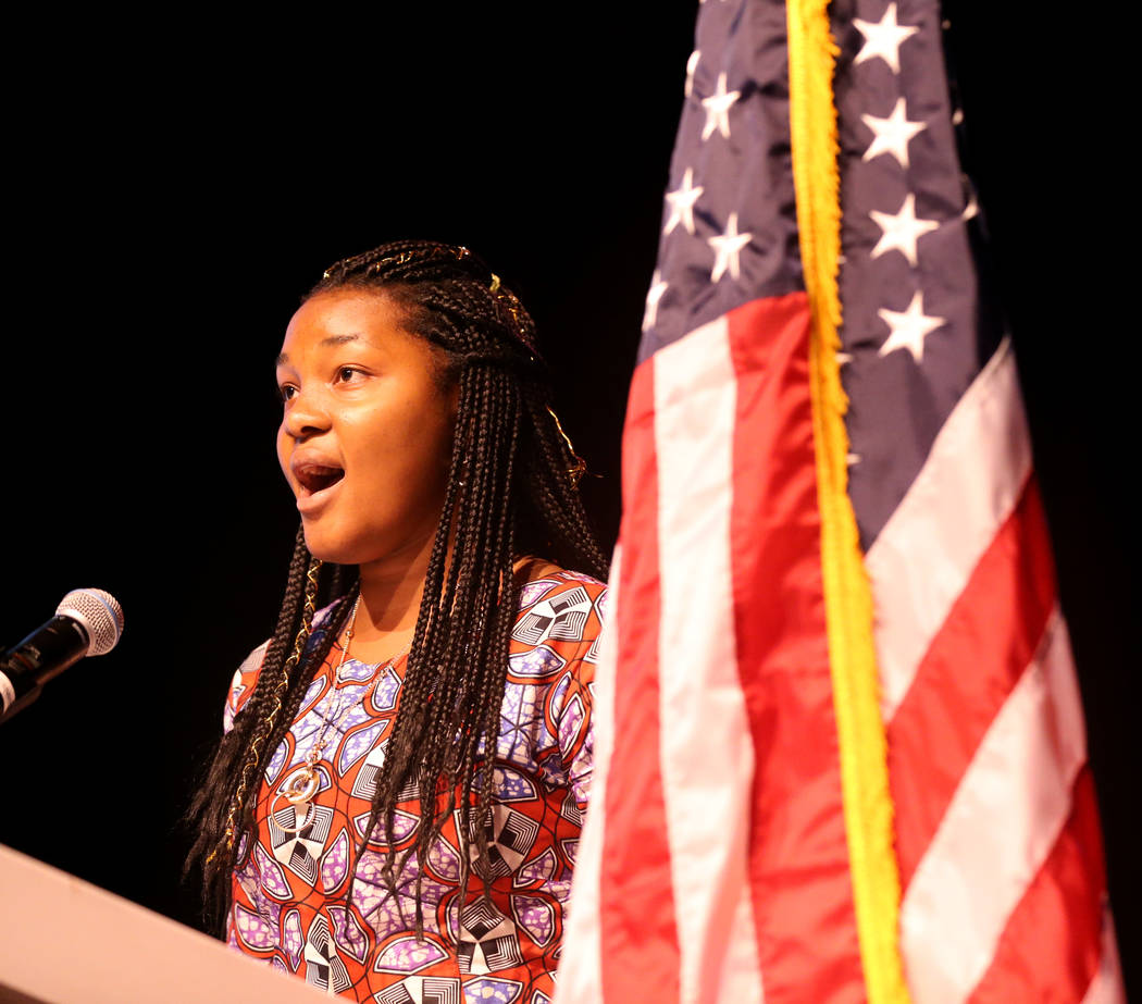 Rosy Mibulano, 19, sings the national anthem during the Second Annual Refugee Recognition Ceremony at the Silverton in Las Vegas Wednesday, June 20, 2018. Mibulano, from the Democratic Republic of ...