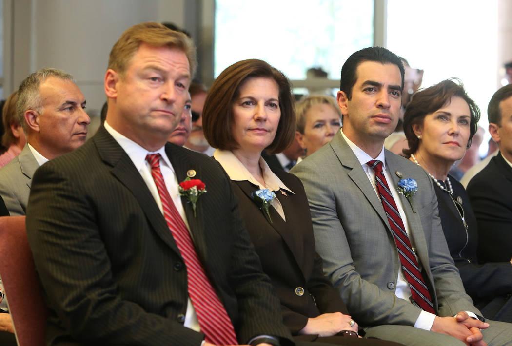 Sen. Dean Heller, R-Nev, left, Sen. Catherine Cortez Masto, D-Nev, U.S. Rep. Ruben Kihuen, D-Nev, and U.S. Rep. Jacky Rosen, D-Nev, right, attend the Memorial Day event at the Southern Nevada Vete ...