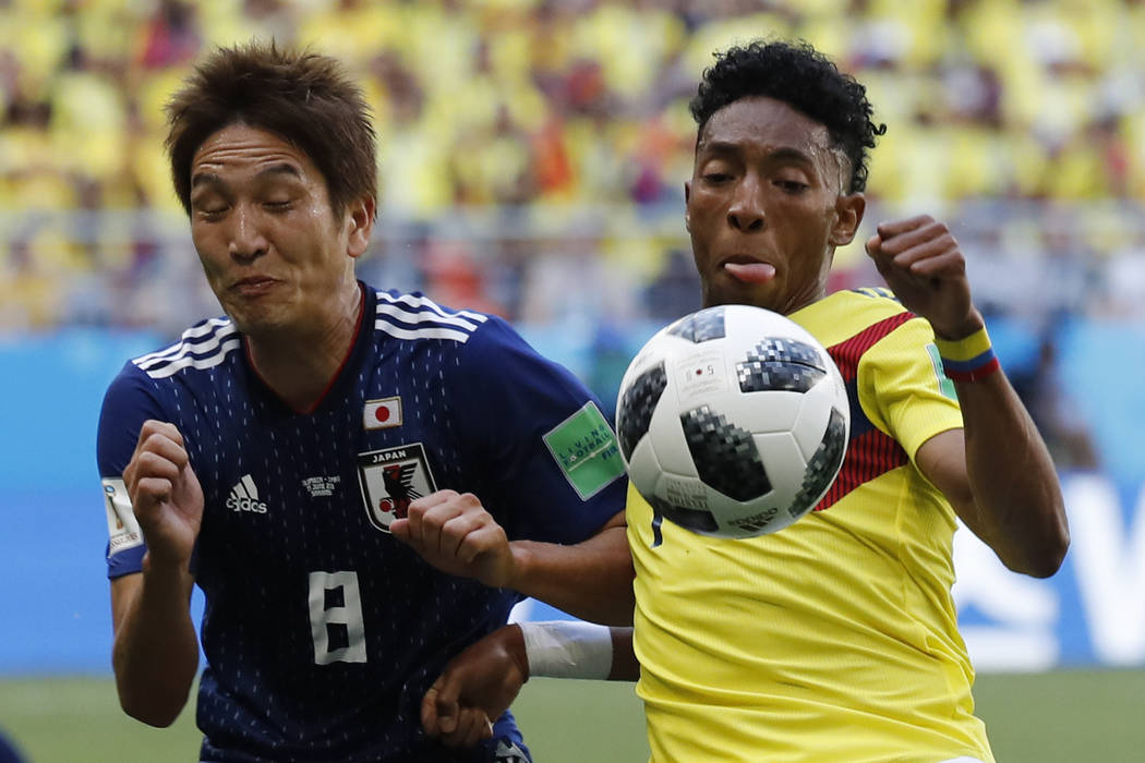 Japan's Genki Haraguchi, left,a dan Colombia's Johan Mojica battle for the ball during the group H match between Colombia and Japan at the 2018 soccer World Cup in the Mordavia Arena in Saransk, R ...