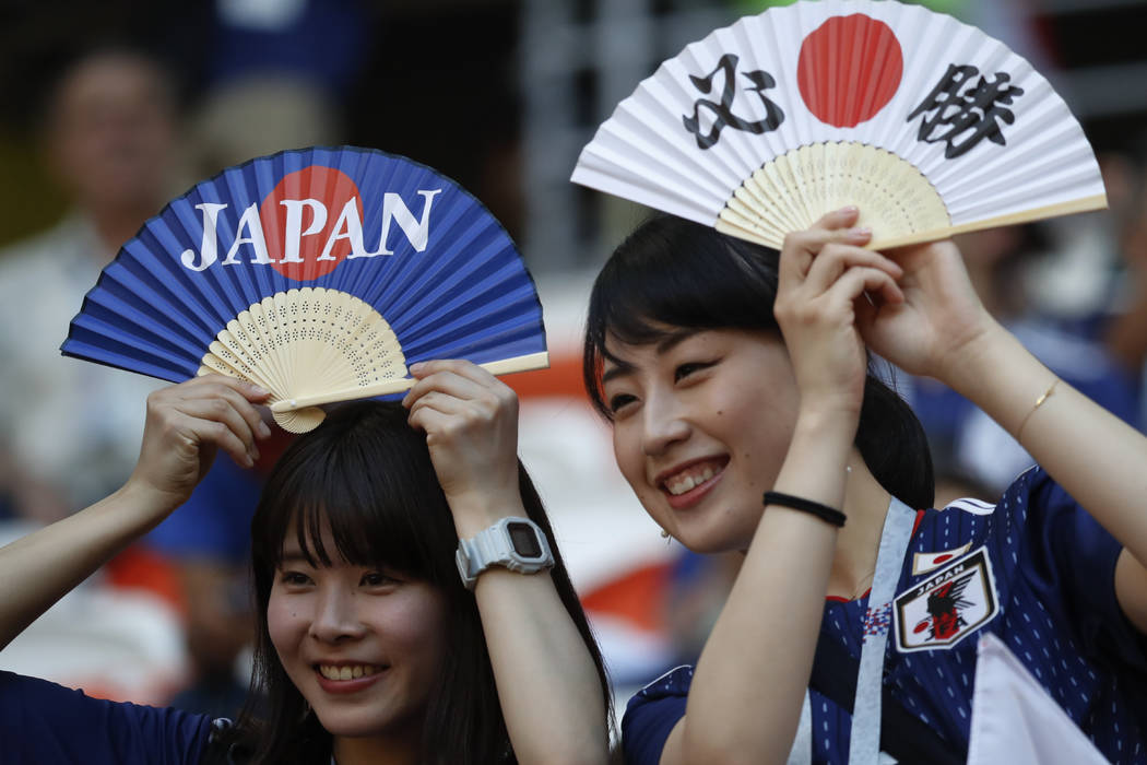 Japan's supporters hold fans prior to the group H match between Colombia and Japan at the 2018 soccer World Cup in the Mordavia Arena in Saransk, Russia, Tuesday, June 19, 2018. (AP Photo/Eugene H ...