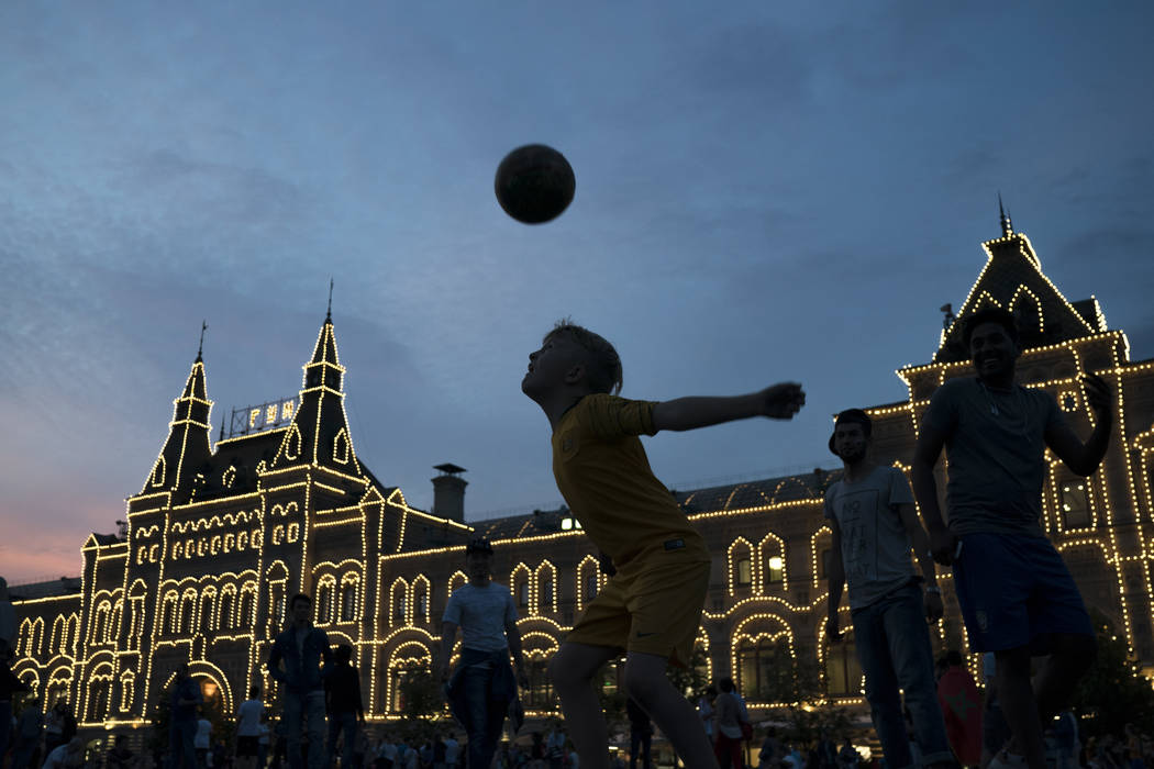 People play soccer at the Red Square during the 2018 soccer World Cup in Moscow, Russia, Tuesday, June 19, 2018. (AP Photo/Felipe Dana)