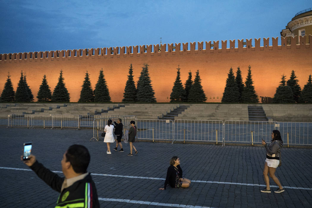 Tourists take photos at the Red Square during the 2018 soccer World Cup in Moscow, Russia, Tuesday, June 19, 2018. (AP Photo/Felipe Dana)