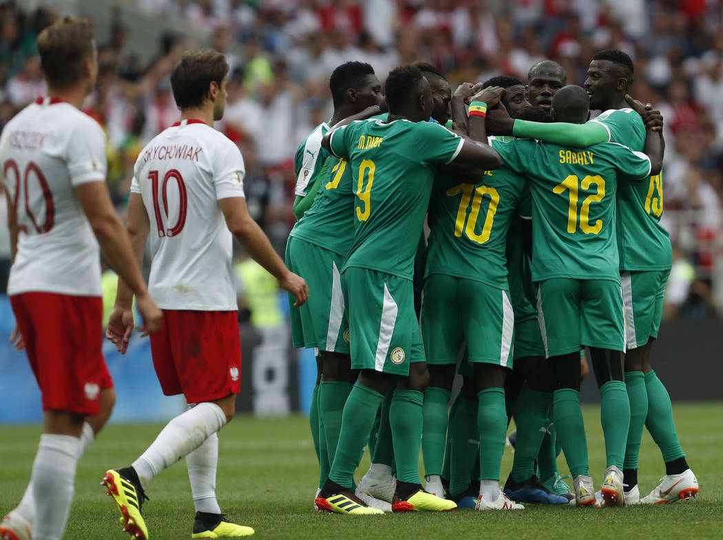 Senegal's Idrissa Gana Guey celebrates with teammates after scoring the opening goal during the group H match between Poland and Senegal at the 2018 soccer World Cup in the Spartak Stadium in Mosc ...