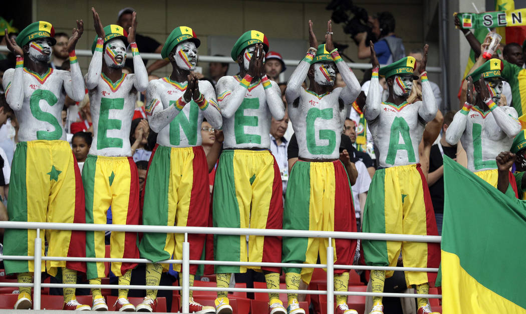 Senegal's fans, their bodies and faces painted in the colors of the national flag, support their team during the group H match between Poland and Senegal at the 2018 soccer World Cup in the Sparta ...
