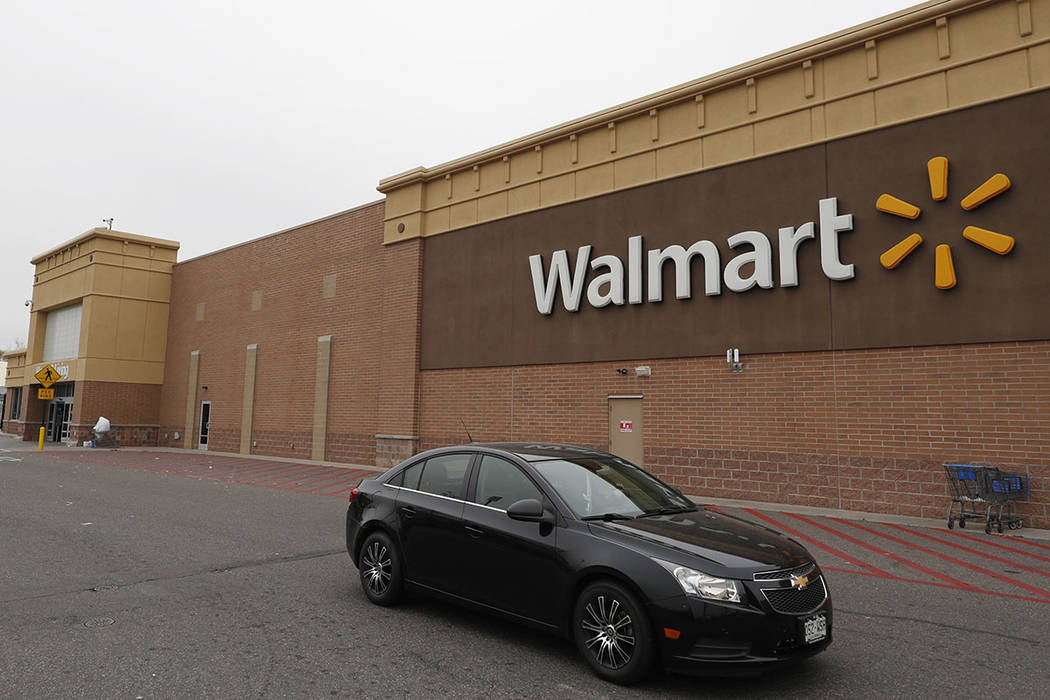 A vehicle passes by a Walmart store Thursday, Nov. 2, 2017, in Thornton, Colo. (AP Photo/David Zalubowski)